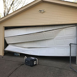 damaged-panels-of-sectional-door